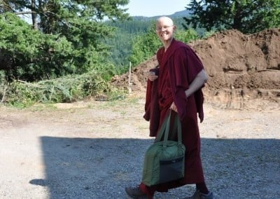 Venerable Tarpa smiles as she leaves for a month-long break from her role as project manager for Chenrezig Hall. She goes to Deer Park in Wisconsin to receive teachings.
