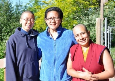 Dharma sisters Ruby, Charis, and Venerable Drolma enjoy the sunshine.