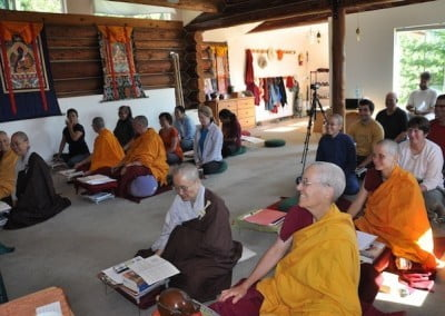 A full hall of sincere practitioners of the Dharma share a joyful moment.