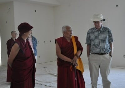 Venerable Chodron takes our guests on a tour of Chenrezig Hall.