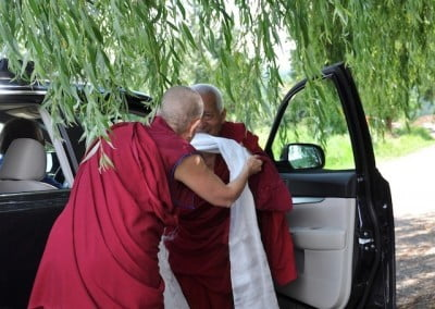 Venerable Chodron offers Geshela a kata and welcomes him to the Abbey.