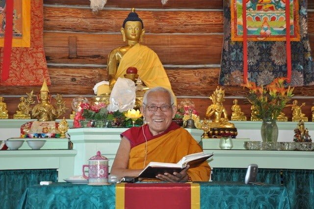 Geshe Thabkhe shares his love of the Dharma with a brilliant smile.