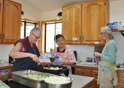Venerabe Yeshe has some wonderful help with Susan and Chris  assisting in the kitchen.