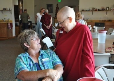Venerable Thubten Jigme connects with Dharma friend Sarah at the recent Sharing the Dharma Day.