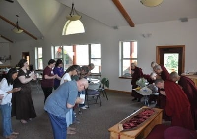 The sangha receives food offering from our guests.