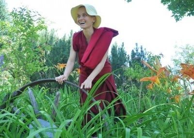 Venerable Thubten Jampa with the lilies in the garden.