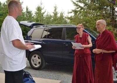 Visiting the Abbey for the first time, Josh is greeted by Venerables Thubten Chodron and Samten.