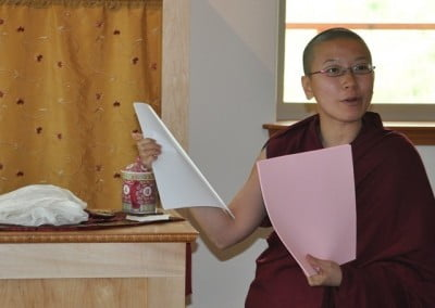 Venerable Thubten Damcho explains Abbey etiquette to the guests.