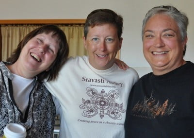 Tracy, Tree, and Jen—stalwarts of the volunteer food offering team—are glad to see each other.
