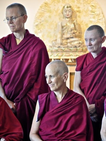 Venerables Thubten Chodron, Tarpa, and Samten listen as another monastic expresses her  appreciation of all our volunteers.