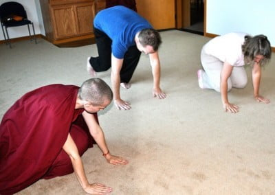 Ven. Jampa enjoys instructing new guests on the fine art of prostrating.