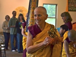 With 4-armed Chenrezig in hand, Venerable Thubten Chodron leads an offering procession throughout the building.