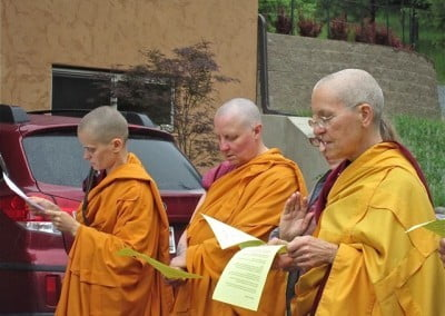 Venerables Thubten Jampa, Tsultrim and Semkye help invoke the blessings of all the Buddhas.