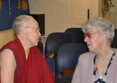 Venerable Gache who is visiting the Abbey shares some quiet conversation with Elaine.