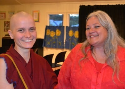 Jamie, who is the office manager for Youth Emergency Services, shares her delight with Venerable Thubten Jampa.