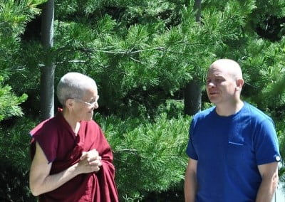 Venerable Thubten Semkye connects with Sean during the break time.