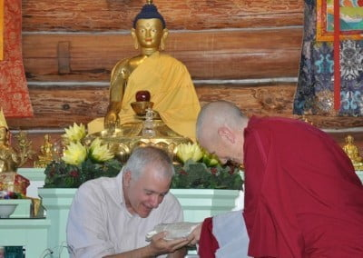 Venerable Thubten Chodron makes an offering to Guy on behalf of all the attendees.