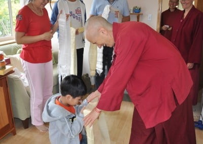 Gelek offers Venerable Thubten Chodron a khata.
