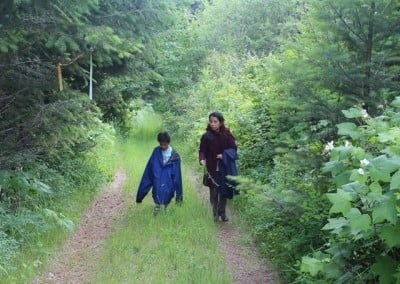 Mother and son take a quiet walk.
