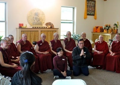 "Boon Wan and Lai Pueh, Venerable Thubten Damcho's parents, with all their ""daughters""—the Abbey sangha."