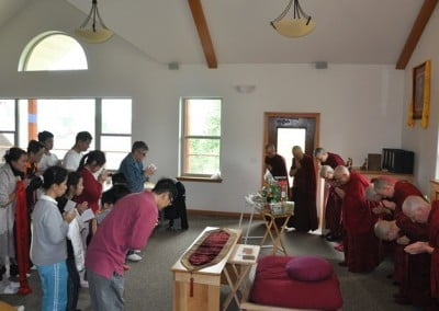 The families make a food offering to the sangha.
