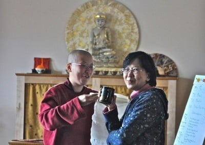 Venerable Thubten Damcho consults with her visiting mom, Boon Wan, before the consecration day.