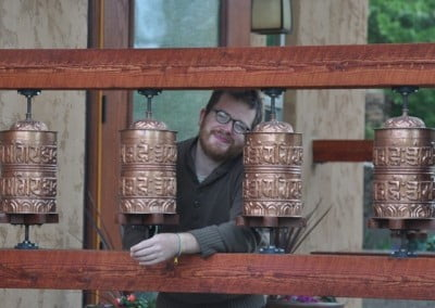 Andrew and the Abbey prayer wheels.