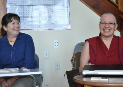 Ven. Yeshe and Tracy find life amusing as they prepare to receive teachings.