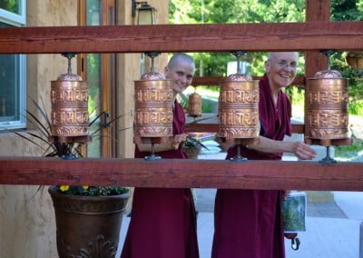 Ven. Semkye and Ven. Jampa turn the prayer wheels.