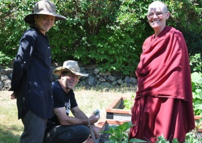 Offering Service Saturdays instigators Sarah and Doug join Ven. Chonyi in the garden.