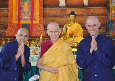 A Buddhist nun flanked by two new anagarikas