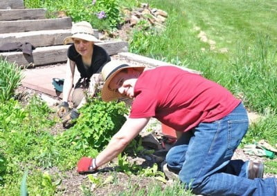 Chris and Kristin, who traveled from North Dakota,  help with garden care after lunch.