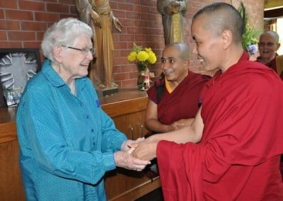 Venerable Choedon greets Sr. Teresa Rose, who will be celebrating her  75th <br> year of monastic life this year.