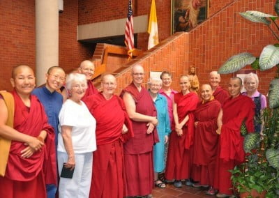 Catholic and Buddhist nuns outside the chapel during a tour of the care facility.