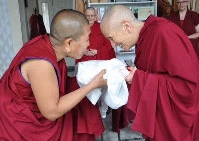Venerable Chonzum makes an offering to Venerable Chodron.