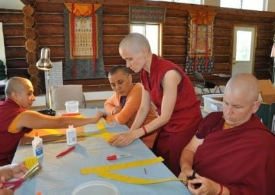 Venerable Jampa guides the nuns in mantra rolling.