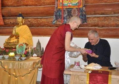 A Buddhist nun offers a gift to a man