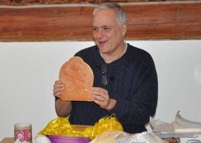 A man holds a Manjushri tsa-tsa