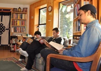 A group of people sitting and reading books