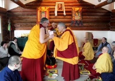 A Buddhist nun offers a gift to another nun
