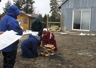 Buddhist nuns and others start a fire outside