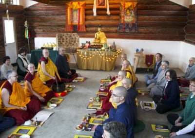 Rows of monastics and lay people in the Meditation Hall