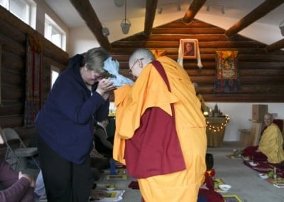 Venerable Chonyi offers a gift to Lynn for her work on the Sravasti Abbey Friends Education (SAFE) online Dharma study program.