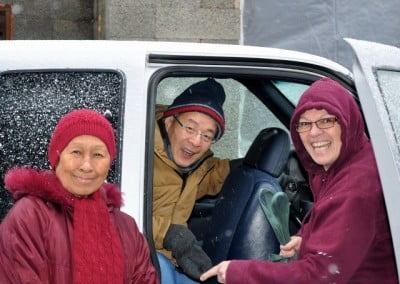 Brian, Venerable Dronsel, and Venerable Yeshe say goodbye as they depart the Abbey after retreat.