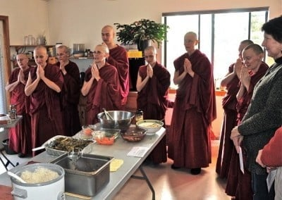 With a prayer of gratitude, the sangha respond to the generosity of our guests who offered food.