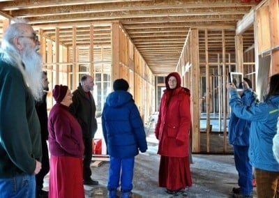 Venerable Tarpa leads guests and residents on a tour of Chenrezig Hall
