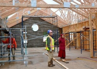 Venerable Chodron visits the site to say hi and check on the progress.