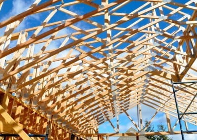 A clear blue sky enhances the complex, geometric shapes of the trusses.