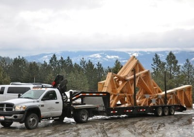 A truck arrives at the Abbey hauling trusses on a trailer.