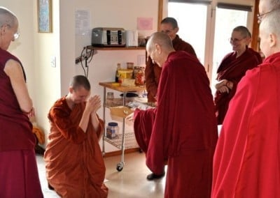 Novice nun, Srammaneri Sumedha, makes an offering to Venerable Chodron, <br> an elder of the sangha. This beautiful ritual is common in the Theravada tradition.